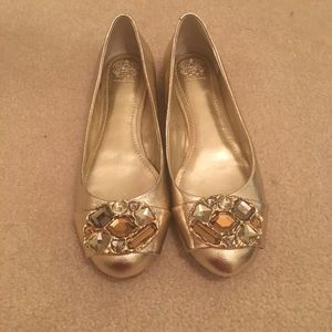 Vince Camuto gold flats.